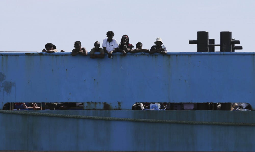 <p>People look out from a ferry as they wait to be evacuated to Nassau in the aftermath of Hurricane Dorian, from the port of Marsh Harbor, Abaco Island, Bahamas, Sunday, Sept. 8, 2019. It's been nearly a week after Dorian roared in from the sea as the most powerful hurricane in the northwestern Bahamas' recorded history.(AP Photo/Fernando Llano)</p>