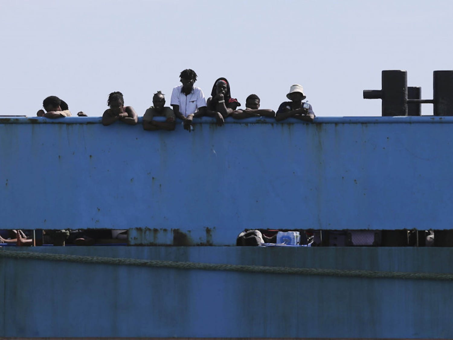 People look out from a ferry as they wait to be evacuated to Nassau in the aftermath of Hurricane Dorian, from the port of Marsh Harbor, Abaco Island, Bahamas, Sunday, Sept. 8, 2019. It's been nearly a week after Dorian roared in from the sea as the most powerful hurricane in the northwestern Bahamas' recorded history.(AP Photo/Fernando Llano)