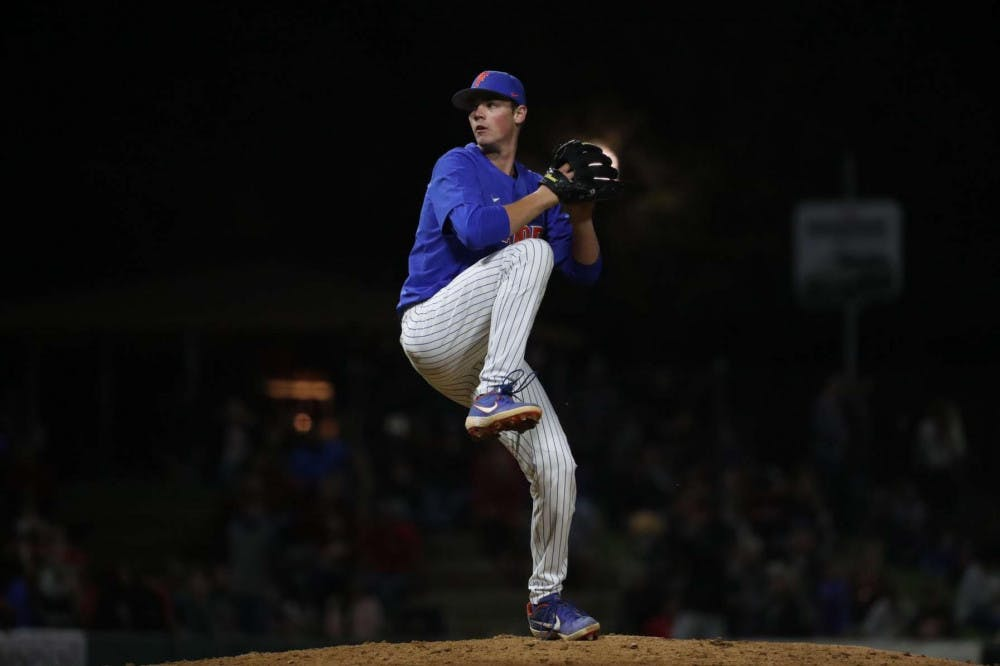 <p>Hunter Barco, a 19-year-old UF business administration freshman, pitches in an exhibition game against Georgia. He threw one inning and struck out three batters against the Bulldogs.</p>