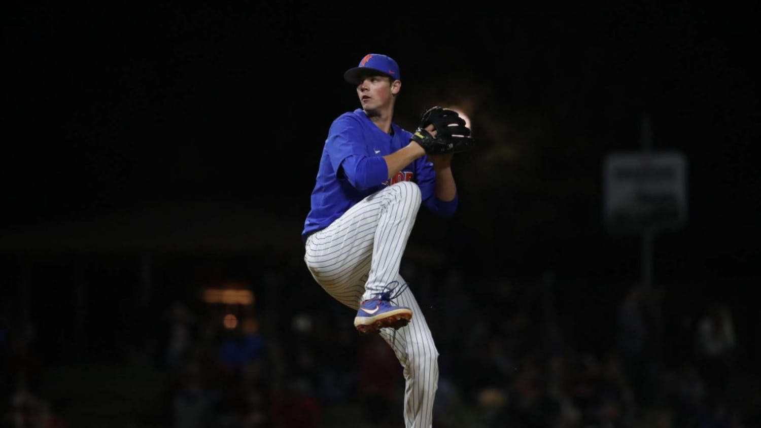Hunter Barco, a 19-year-old UF business administration freshman, pitches in an exhibition game against Georgia. He threw one inning and struck out three batters against the Bulldogs.
