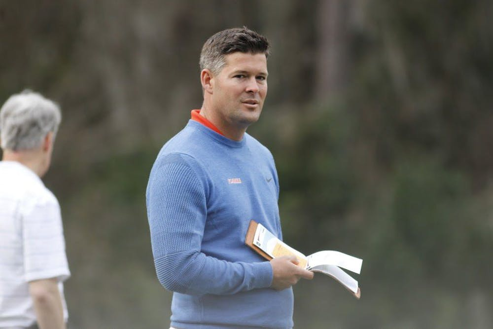 <p>UF head coach JC Deacon holds a scorecard during the 2017 Gator Invitational. Deacon and the Gators head to Scottsdale, Arizona, for the National Championship.</p>