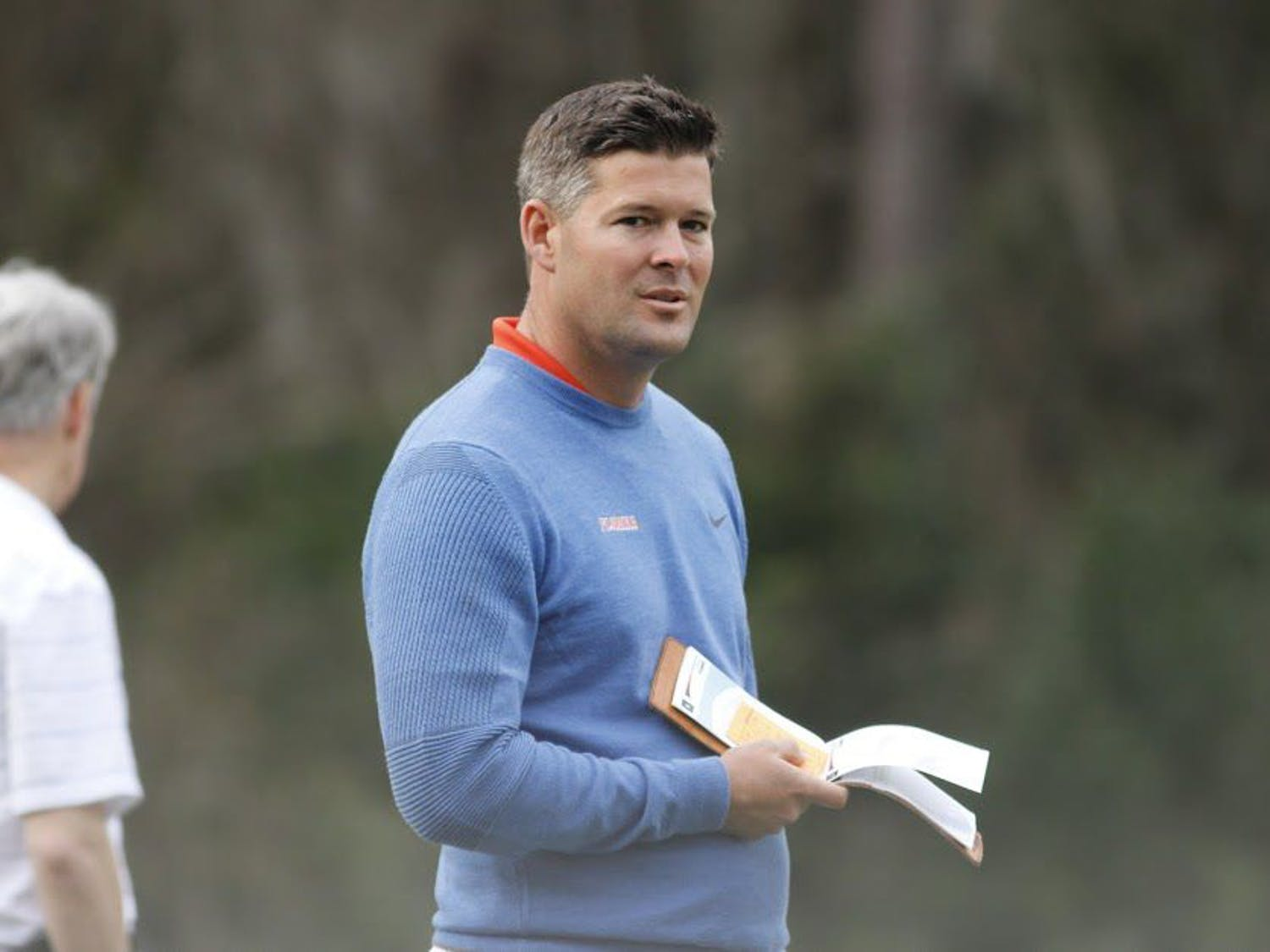 UF head coach JC Deacon holds a scorecard during the 2017 Gator Invitational. Deacon and the Gators head to Scottsdale, Arizona, for the National Championship.