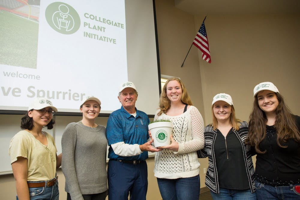 <p>Winner of the Florida memorabilia, Jessica Finkel, poses with former UF coach Steve Spurrier after being chosen to receive a piece of turf from The Swamp.</p>