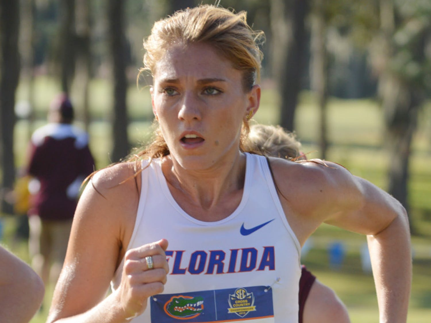 Cory McGee runs in the Southeastern Conference Cross Country Championships on the Mark Bostick Golf Course on Nov. 1, 2013. McGee won her first event of the 2014 track and field season on Jan. 11.