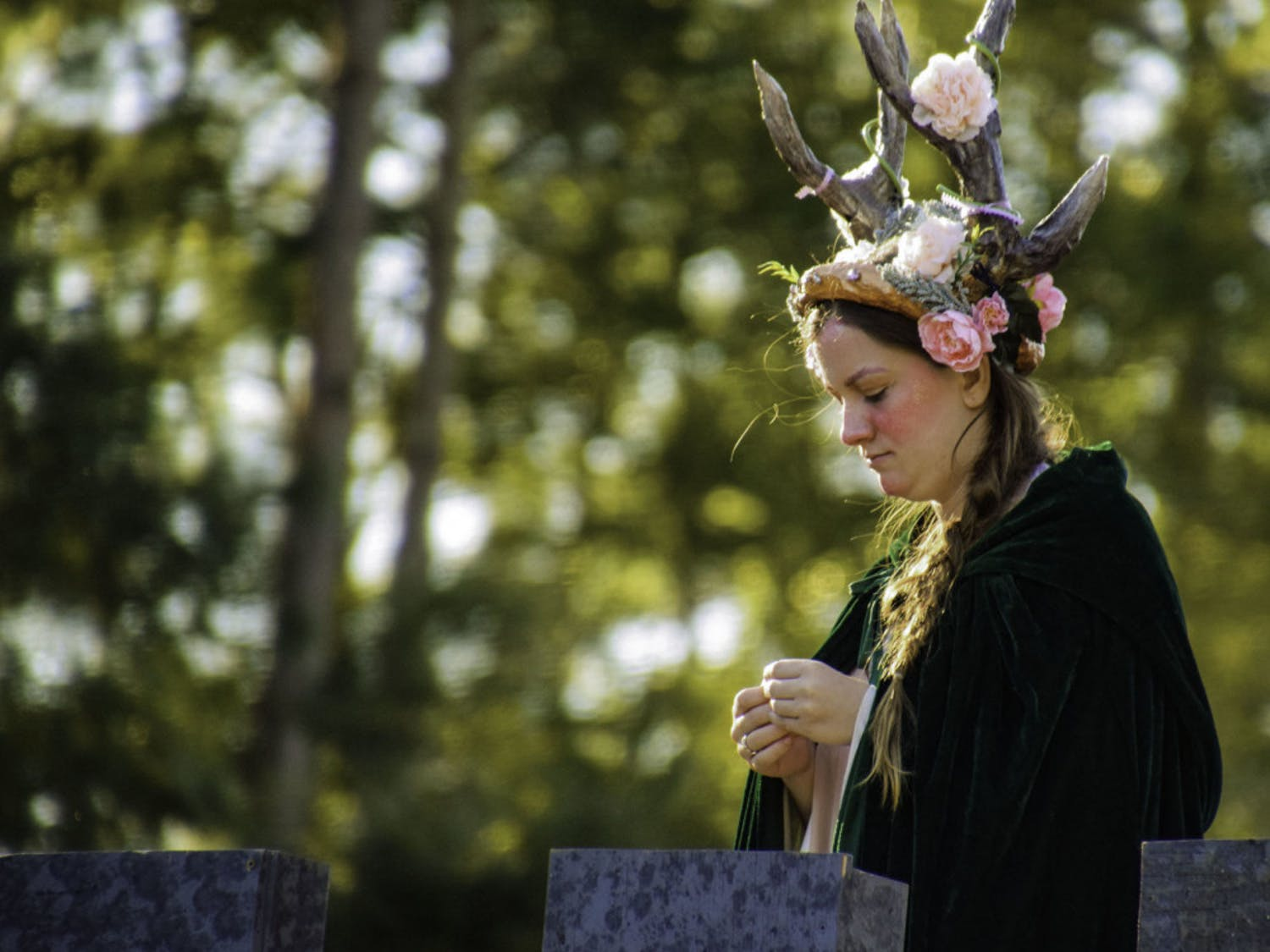 Thieves Guilde actor Ellie Smith, 18, looks down at the chessboard from a prop castle.