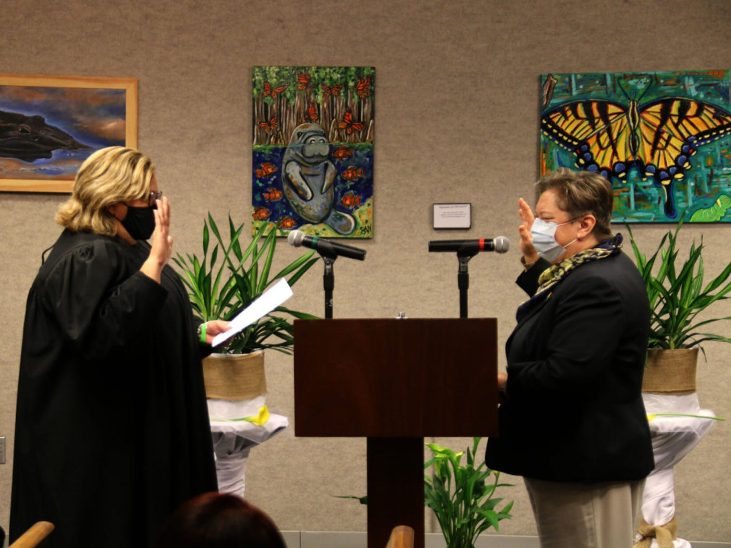 """Mary Alford (right), the Alachua County Commissioner is sworn in by judge Denise Ferraro (left) at the John R. """"Jack"""" Durrance Auditorium on Nov. 17, 2020."""