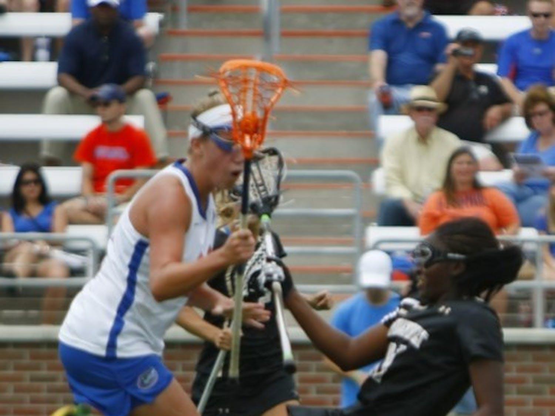 Florida freshman midfielder Nicole Graziano checks Vanderbilt's Brandi Byner during Saturday's 17-5 win against the Commodores.
