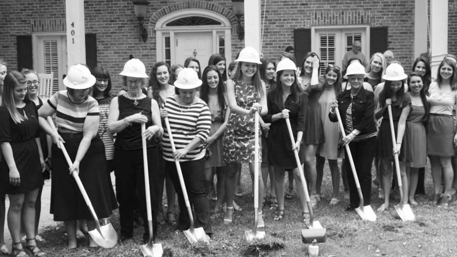 Members of Kappa Kappa Gamma break ground on their new house expansion Sunday afternoon. The renovations, which include an additional laundry room, are scheduled to be completed by Fall.