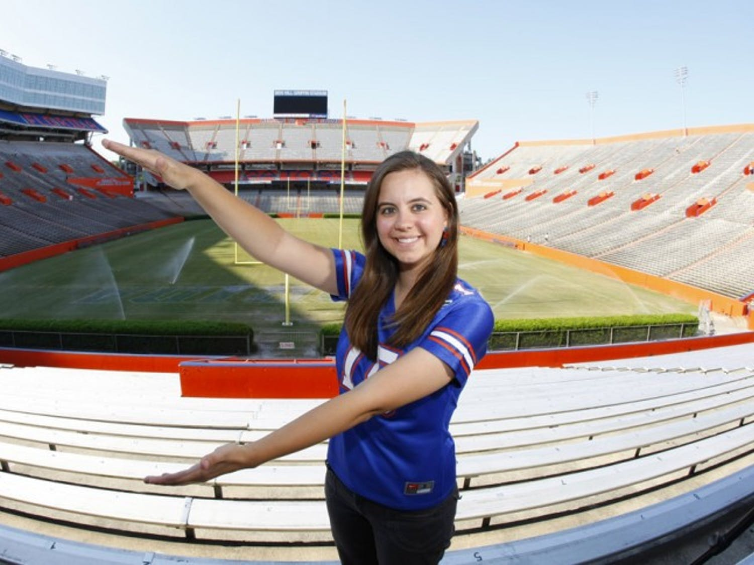 Elizabeth Graham, winner of ESPNU's Ultimate College Sports Fan contest, poses in Ben Hill Griffin Stadium on Wednesday.