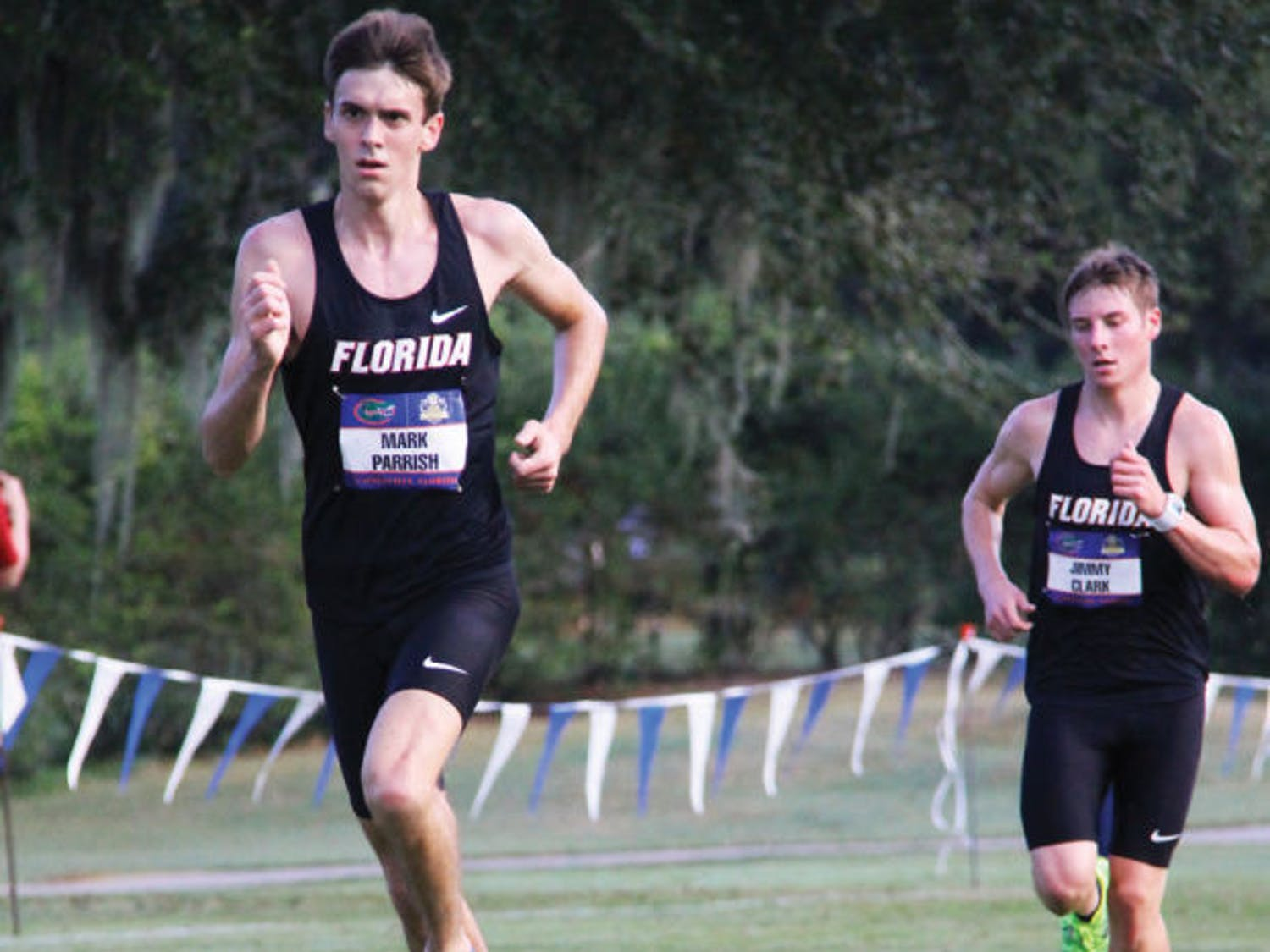Mark Parrish (left) and Jimmy Clark run during the SEC Championships on Nov. 1 in Gainesville. The NCAA Championships begin today.