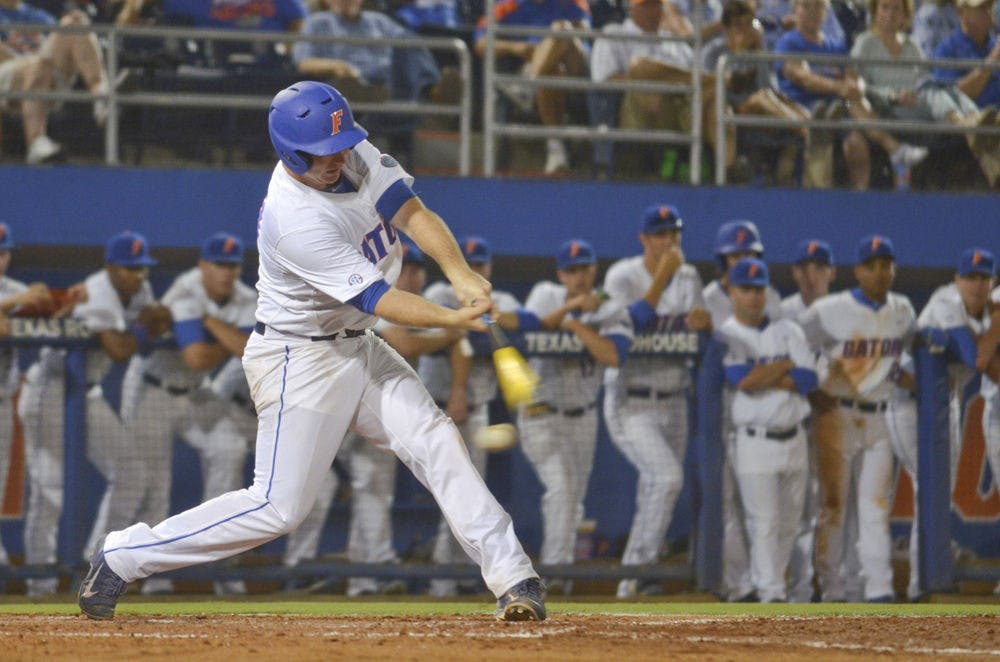 <p>UF's Peter Alonso bats during Florida's win against South Carolina on April 10, 2015, at McKethan Stadium.</p>