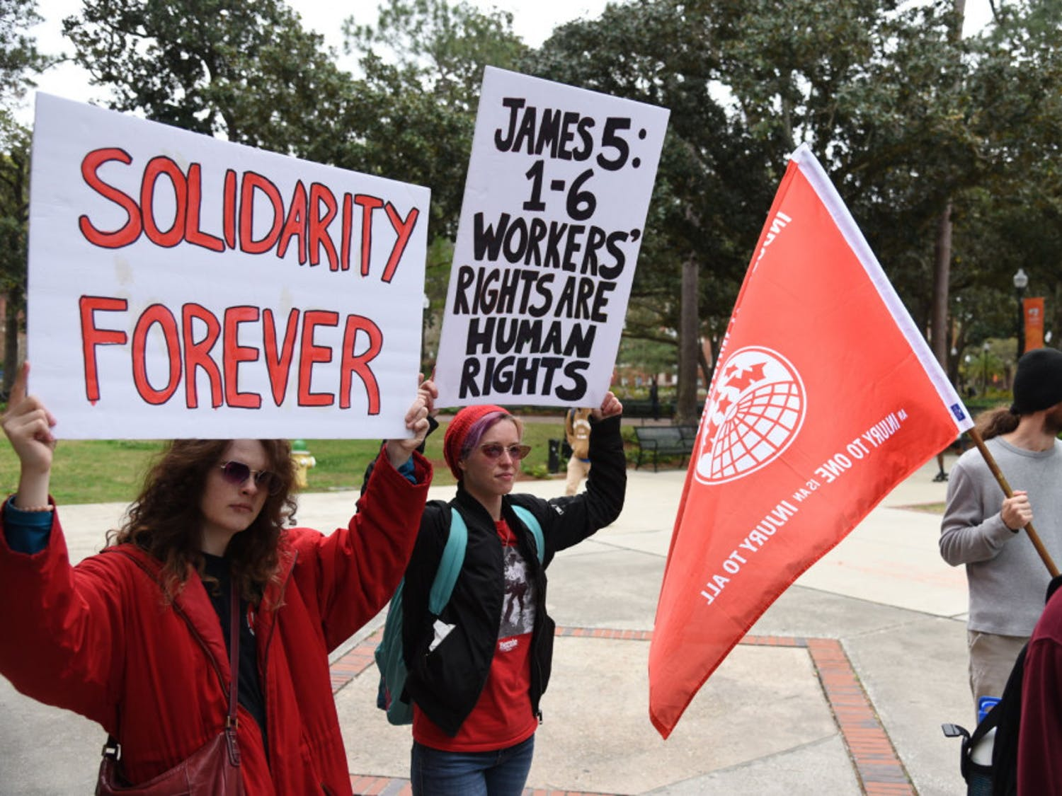 Almost 50 protesters gather outside President Kent Fuchs' office on Feb. 21 to advocate for better working conditions and wages from Aramark, UF's food service company. A new coalition plans to protest virtually in light of the COVID-19 outbreak.