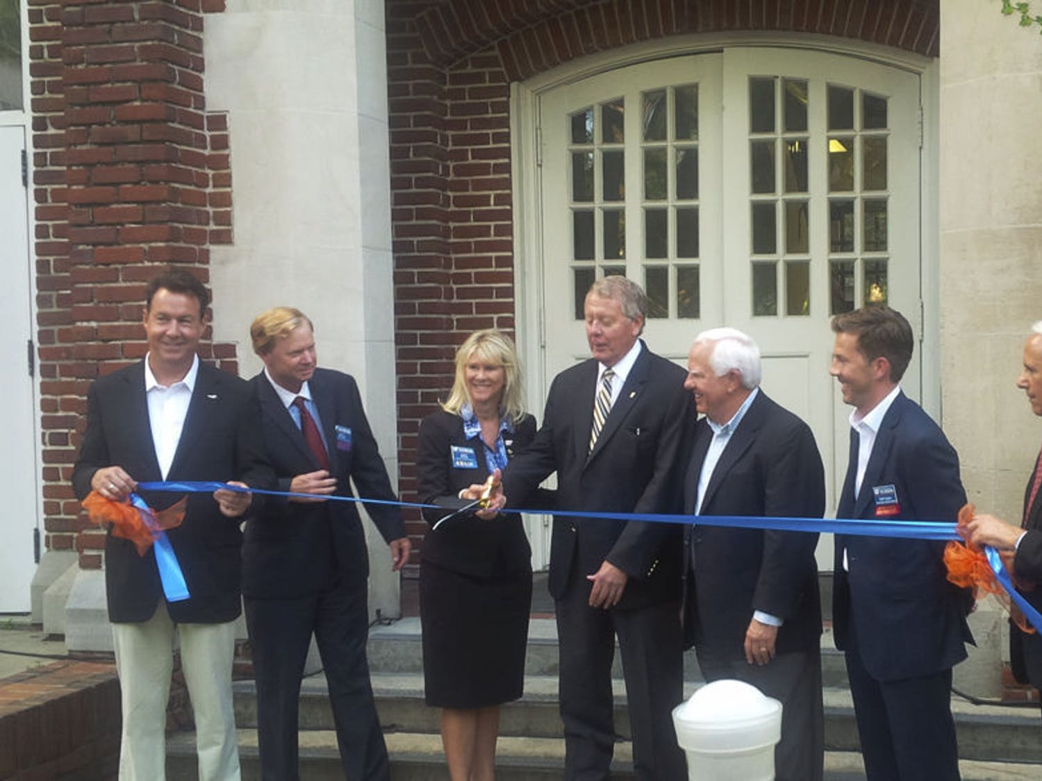 John Kraft, far right, Dean of the Warrington College of Business, watches during the ribbon-cutting of the newly renovated Kelley A. Bergstrom Center for Real Estate Studies at Bryan Hall in September 2015.