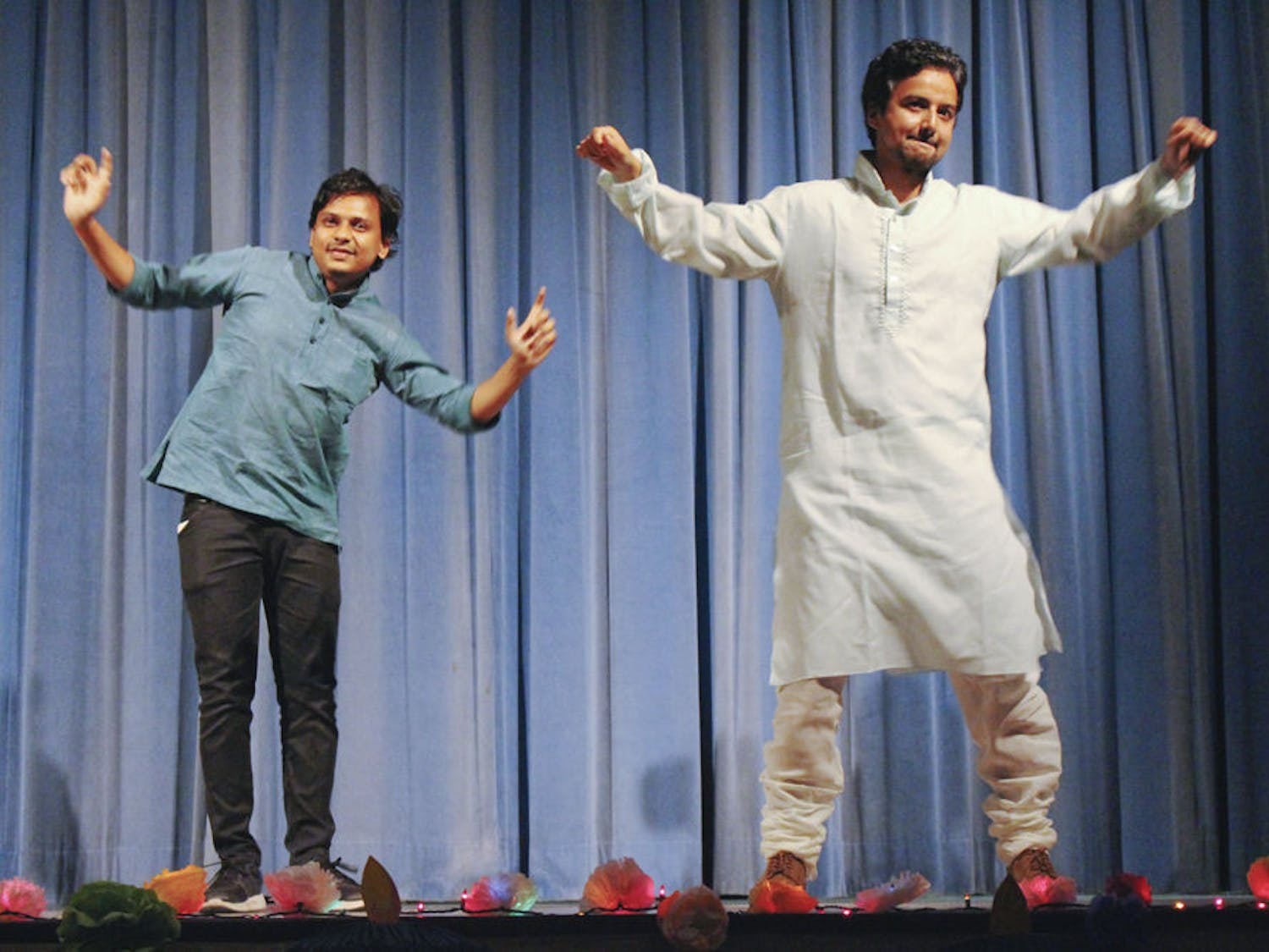 Biswas Rijal, right, a UF materials science graduate student, was cajoled into doing a traditional dance from North India called bhangra in front of about 600 people celebrating Diwali at the India Cultural and Education Center on Nov. 14, 2015. He pulled his friend, Gaurav Sultania, left, a UF civil engineering graduate student, onstage with him so he wouldn't have to perform alone.
