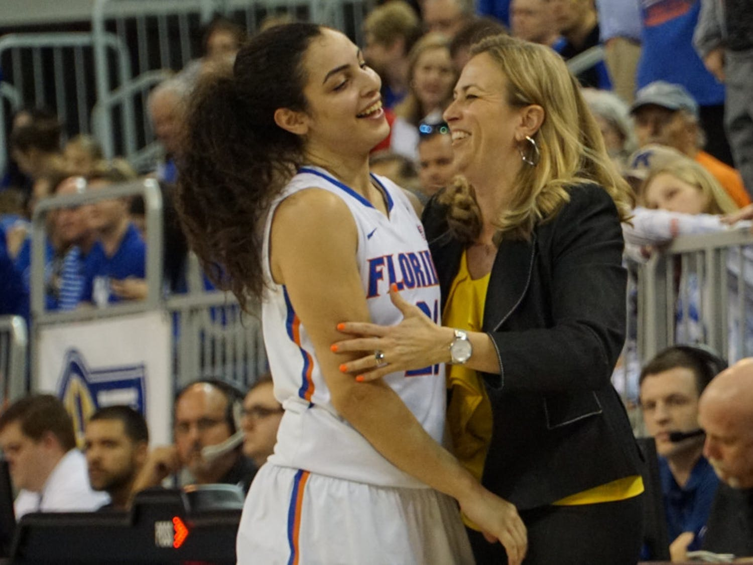 Coach Amanda Butler (right) celebrates with Eleanna Christinaki during Florida's win over Kentucky on Jan. 31, 2016, in the O'Connell Center.