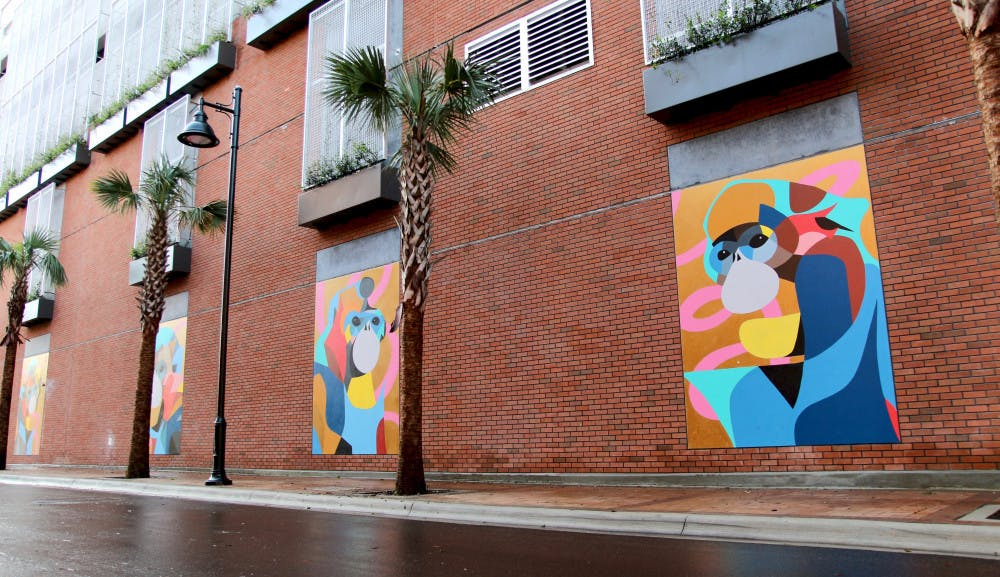 """<p dir=""""ltr""""><span>Four colorful murals of monkeys were added to a wall of The Standard Gainesville's parking garage on Northwest Third Avenue as part of a negotiation with the City of Gainesville. The building encroaches on the Florida Department of Transportation's property by less than ten feet.</span></p><p><span></span></p>"""