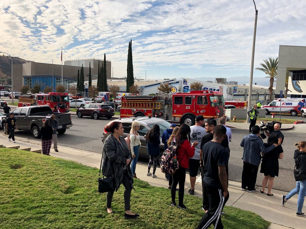 <p>People wait for students and updates outside of Saugus High School after reports of a shooting on Thursday, Nov. 14, 2019, in Santa Clarita, Calif. (AP Photo/Marcio Jose Sanchez)</p>