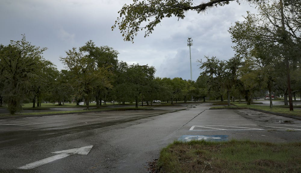 An empty parking lot located at 2286 SE Hawthorne Road on Sunday, July 4, 2021. A proposed new grocery store, called Bravo supermarket, that would buy locally grown food options, may be built in this area.