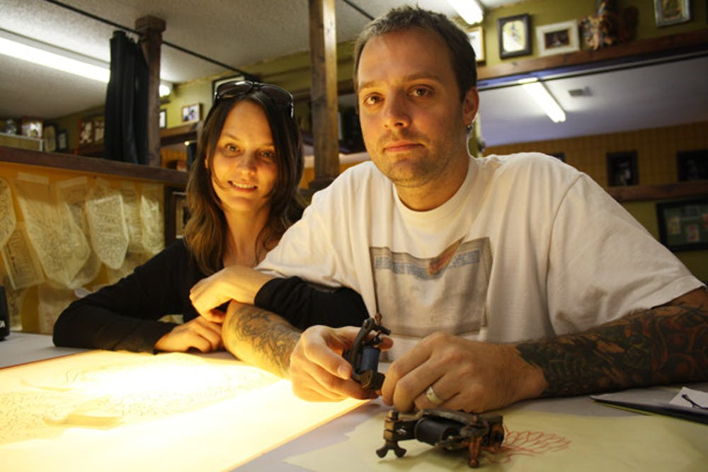 <p>Mike Salay and his wife, Samantha, took over ownership of Anthem Tattoo Parlor on Sept. 2.</p>