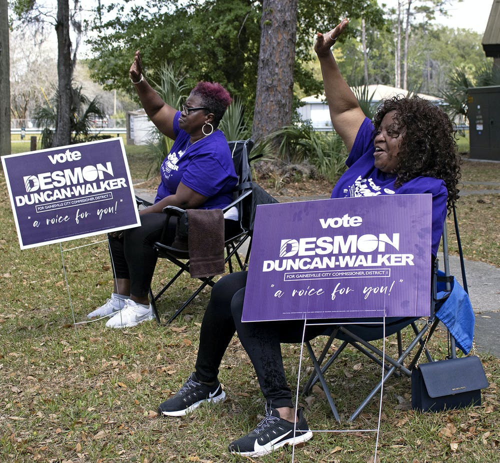 Peggy Golston, 63, (left) and Brendel Lovette, 67, (right) picket at the Mt. Carmel Baptist Church Precinct 30 polling place to show their support for Desmon Duncan-Walker, the District 1 Gainesville City Commissioner-elect, on Tuesday, March 16, 2021.