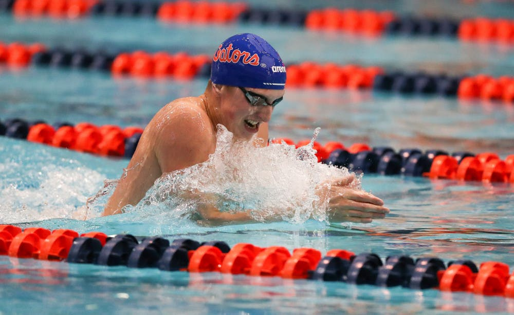 <p>Gators swimmer Kieran Smith comes up to breathe while swimming breaststroke. Smith pulled in seven medals Friday, including four gold</p>