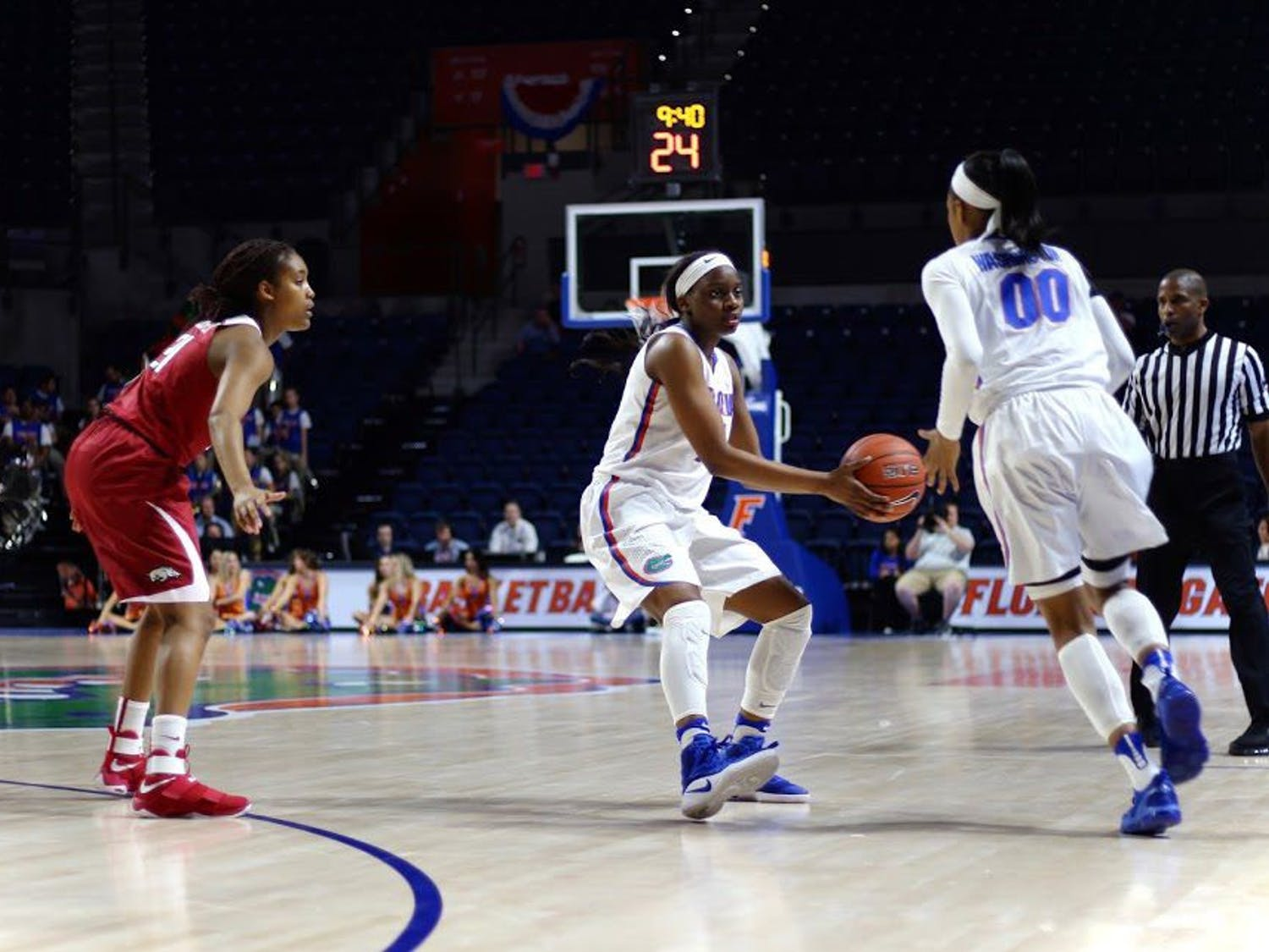 UF guard Dyandria Anderson passes the ball to teammate Delicia Washington during Florida's 57-53 win over Arkansas on Feb. 9, 2017, in the O'Connell Center.