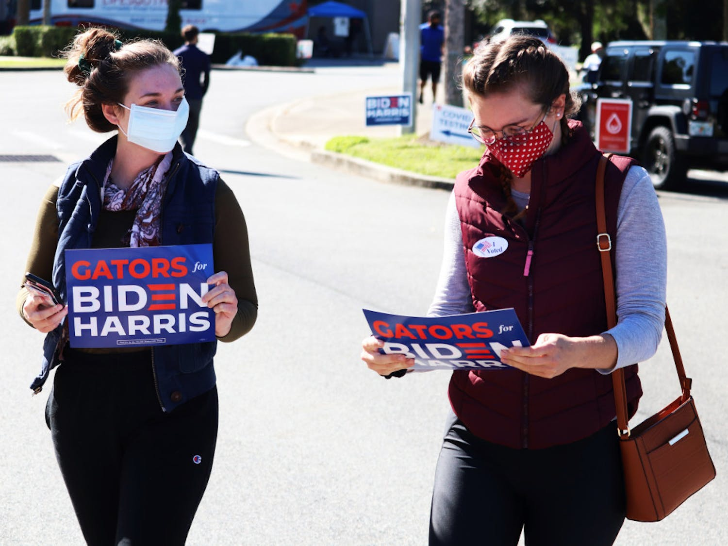 Two UF alumni leave precincts 44 and 54 after voting on Tuesday, Nov. 3, 2020.