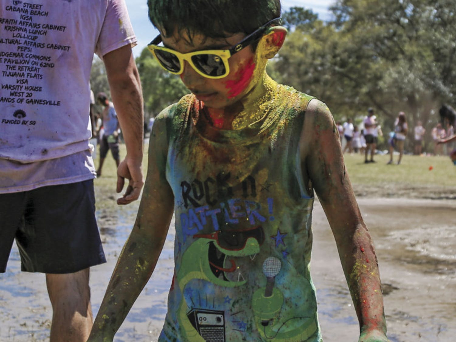 Tanish Vyas, 6, originally from India, celebrates Holi with his family on Sunday afternoon during the UF Holi Festival of Colors, organized by the Indian Student Association and Student Government.