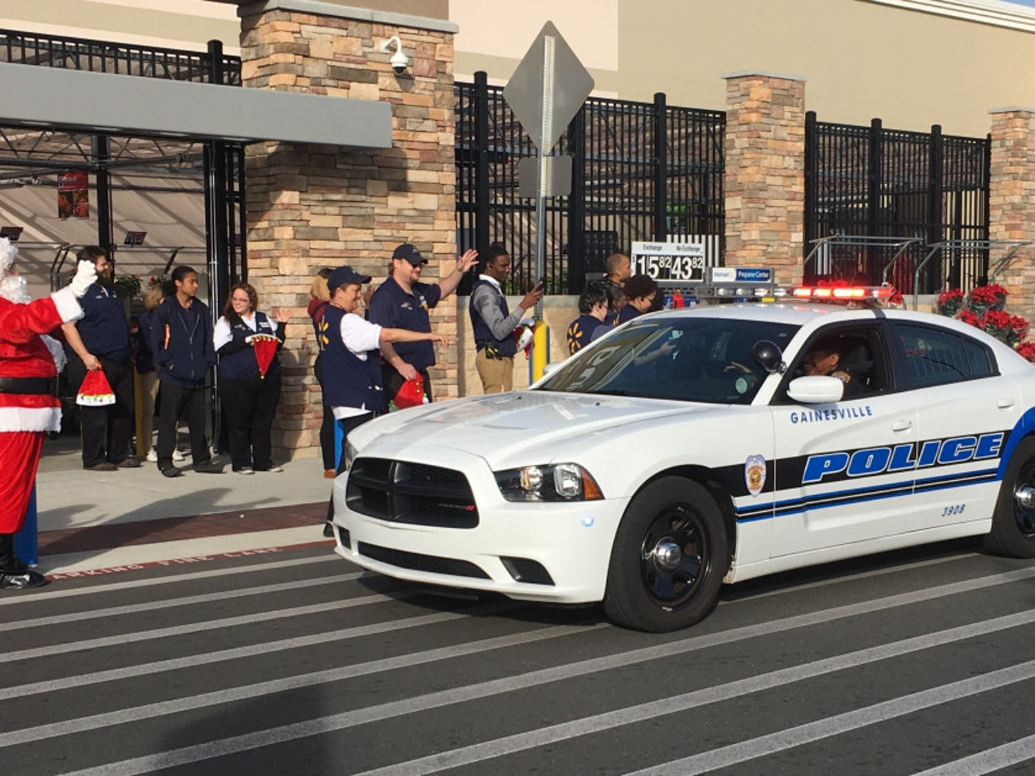 More than 20 Alachua County students arrived at Walmart in police cars. Santa along with an eager group of Walmart employees greeted them before they began shopping.