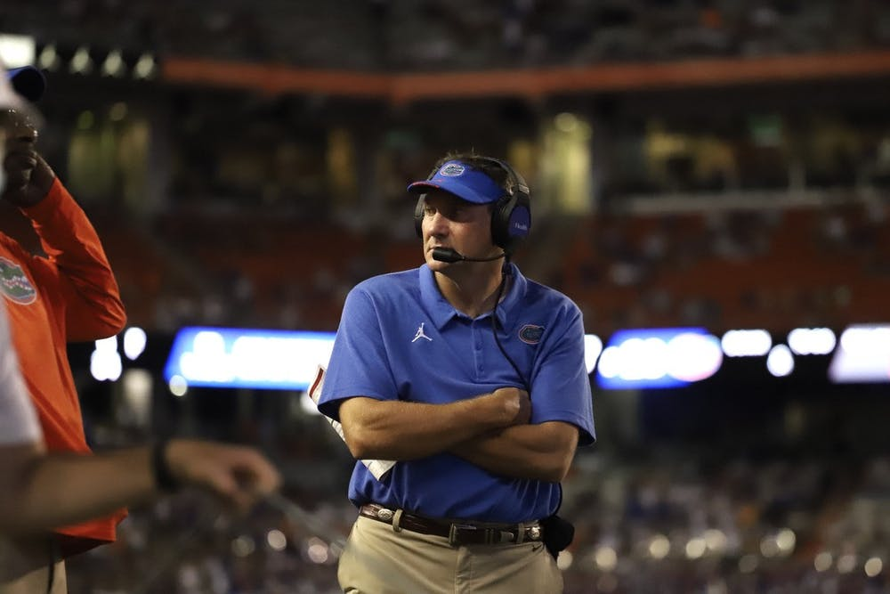 <p>Florida head coach Dan Mullen reacts after FAU scores its first touchdown.</p>