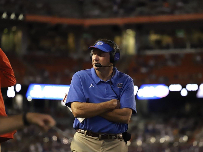 Florida head coach Dan Mullen reacts after FAU scores its first touchdown.