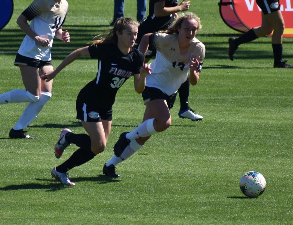 <p>Florida striker Beata Olsson dribbles past a defender Feb. 20 against College of Charleston. The Swedish international scored an early equalizer Monday.</p>