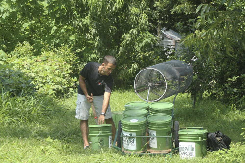 """<p><span id=""""docs-internal-guid-7a3b19a6-66b5-e765-2f74-fe98b9acd27c""""><span>Chris Cano, a founder of Gainesville Compost, helps out at Porters Community Farm. He said Gainesville Compost helps supply the farm with fresh compost for its crops.</span></span></p>"""