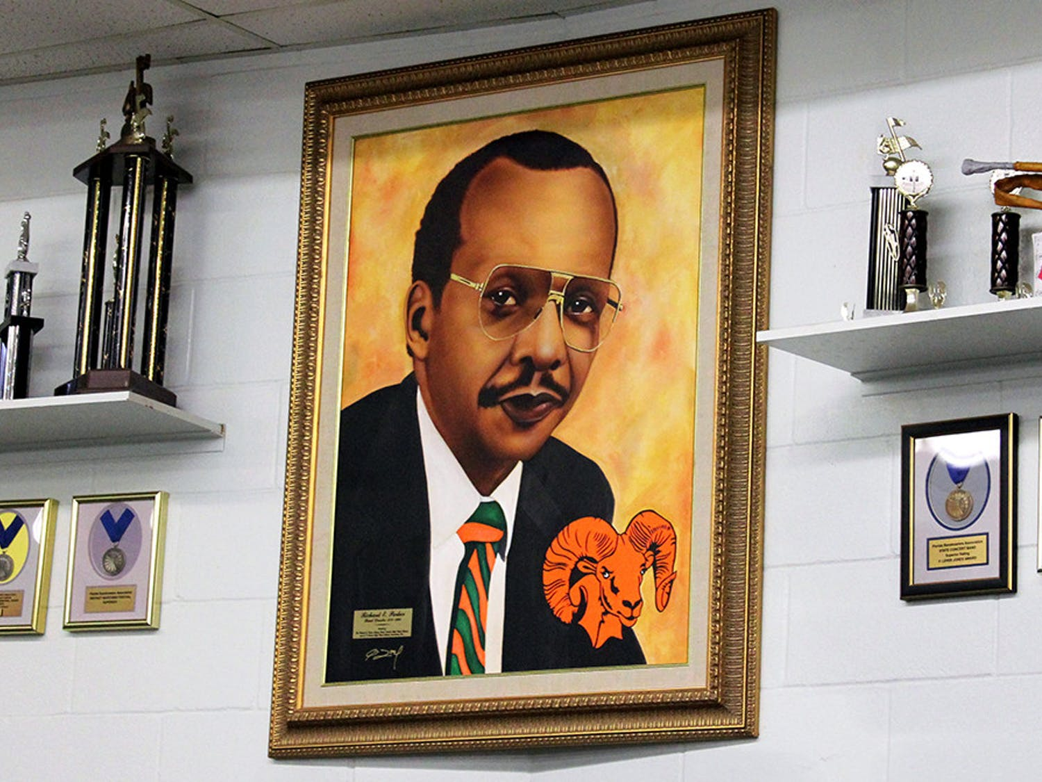 A portrait of former band director Richard E. Parker hangs inside the band room at Eastside High School on Friday, Feb. 12, 2021. Parker was the Eastside marching band director from 1970 to 1990.