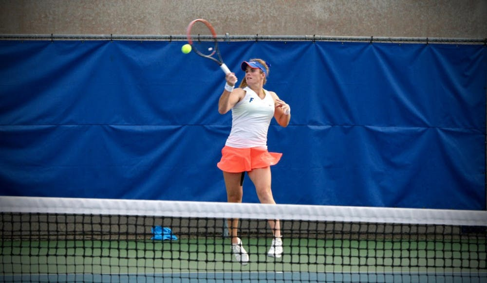 """<p><span id=""""docs-internal-guid-cec37247-5833-2206-94d9-74a9257c6901""""><span>Belinda Woolcock hits a forehand during Florida's 4-2 win against Oklahoma State on Feb. 18, 2017, at the Ring Tennis Complex.</span></span></p>"""
