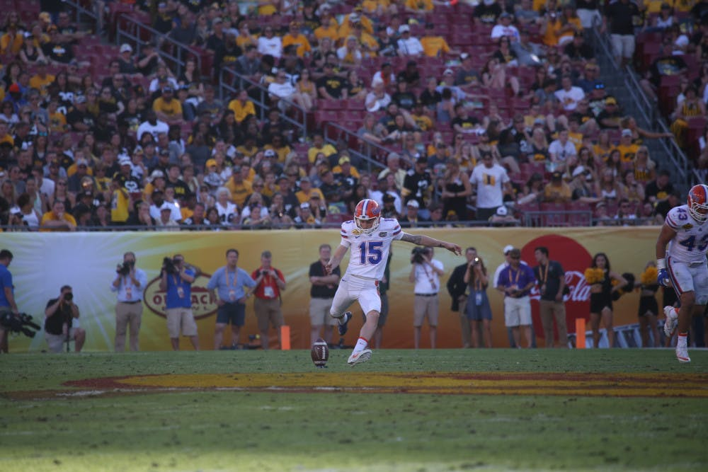 <p>Eddy Pineiro kicks off during UF's 30-3 win over Iowa in the Outback Bowl on Jan. 2, 2017, at Raymond James Stadium.</p>