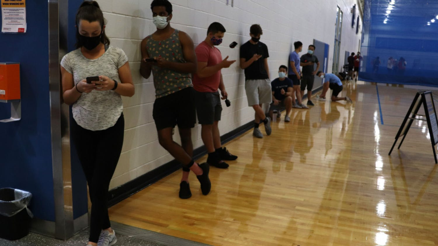 People stand in line to enter the weight room at the Southwest Recreation Center in Gainesville on Monday night, Sept. 21, 2020. According to recsports.ufl.edu, the weight room is open at limited capacity, however the website does not state how many people are allowed at one time.