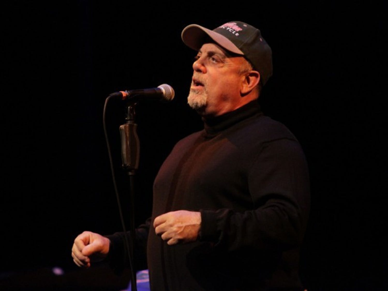 Billy Joel speaks to a packed house at the Phillips Center for the Performing Arts on Thursday night. He performed several songs and answered questions from the crowd about his career and the music business.