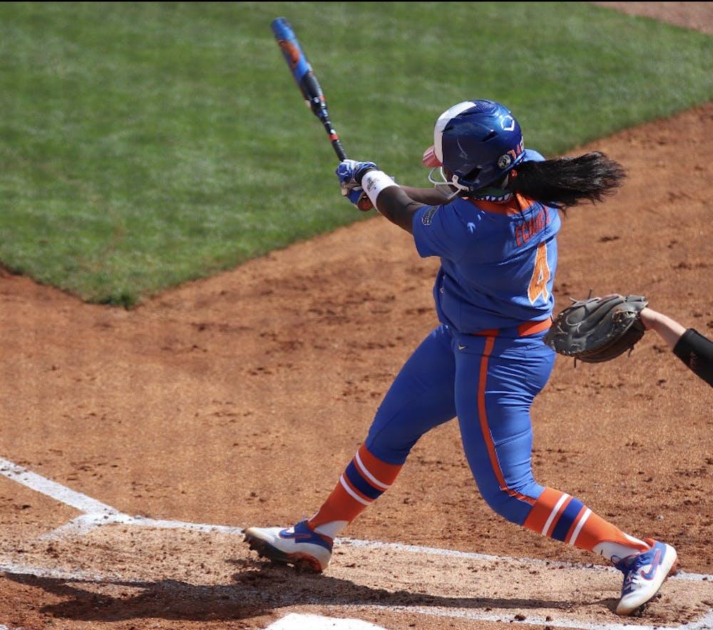 <p>Third baseman Charla Echols swings through a pitch against Louisville on Feb. 27</p>
