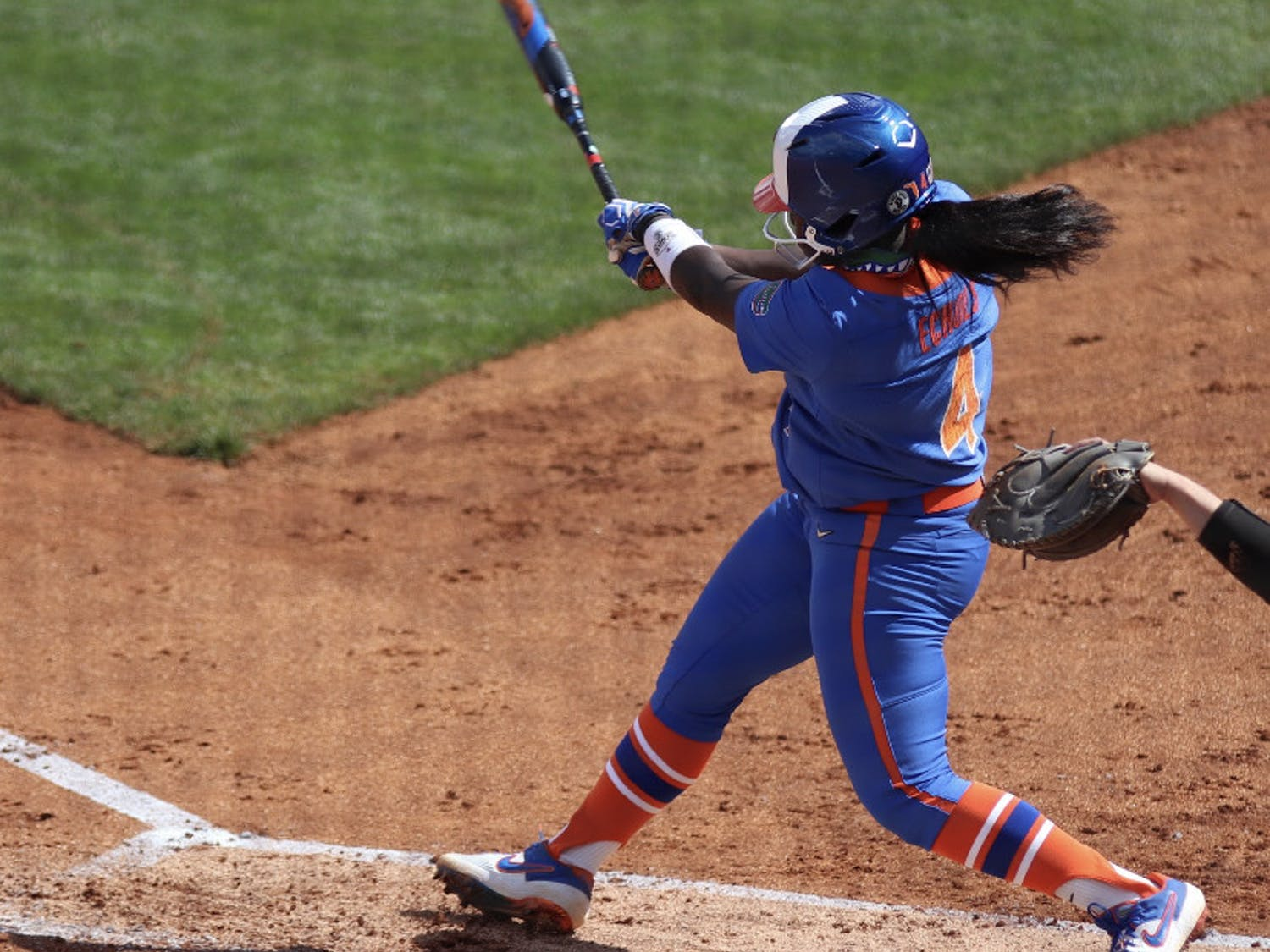 Third baseman Charla Echols swings through a pitch against Louisville on Feb. 27