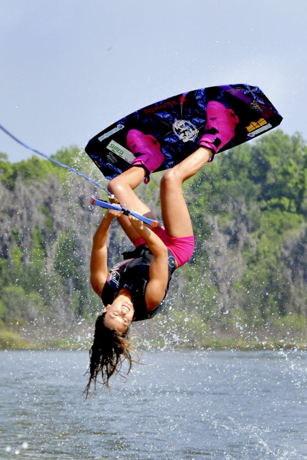 <p>Dixie Smith, a 20-year-old UF biology senior, performs a wakeboard stunt on Lake Wauberg.</p>