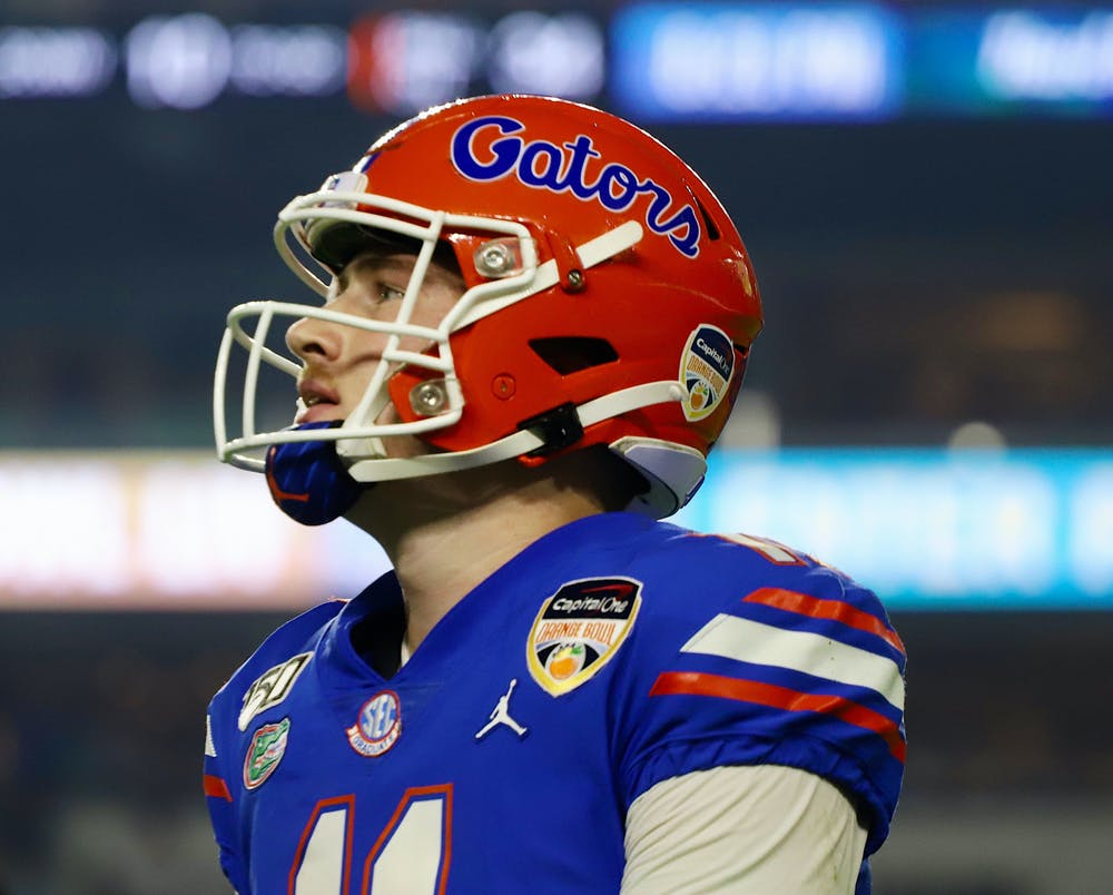 <p>Kyle Trask threw three interceptions in Wednesday's loss to Oklahoma. Photo from UF-Virginia game in December 2019.</p>
