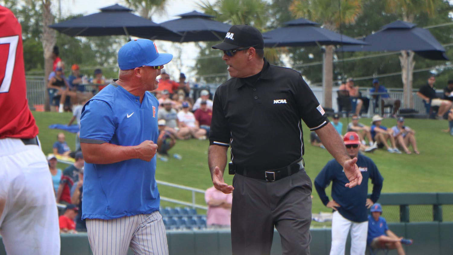 Florida's Kevin O'Sullivan yells at an umpire after a groundout was voided in the sixth inning Saturday. The Gators lost to South Alabama 19-1 to end their season.