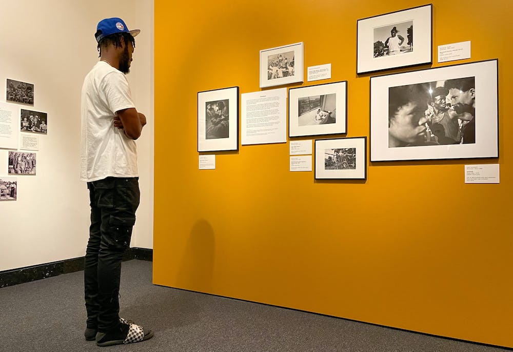 Dolce Douvert, a Gainesville resident looks at photographs in the Harn Museum of Art on Tuesday, July 27, 2021. The photos are part of a new exhibition called Shadow to Substance, which tells African American stories chronologically through historical imagery and modern imagery taken by today's Black photographers.