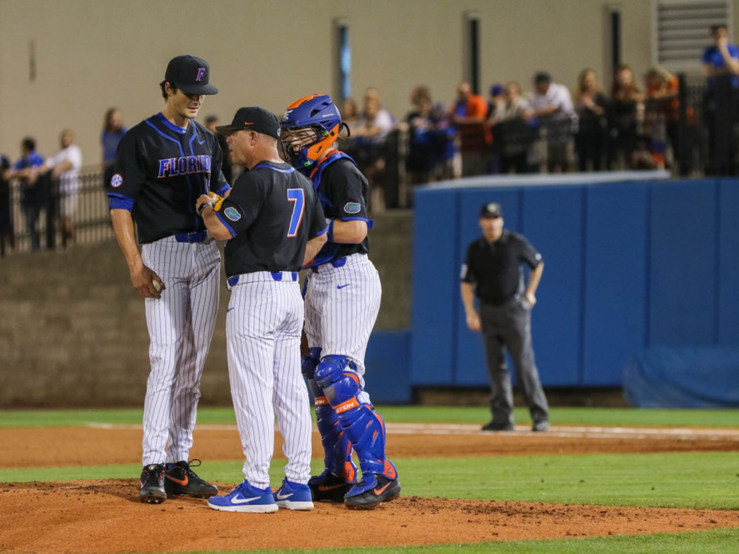 UF pitcher Tommy Mace (left) speaking with coach Kevin O'Sullivan (middle) and catcher Brady Smith (right) during the UM series last year.