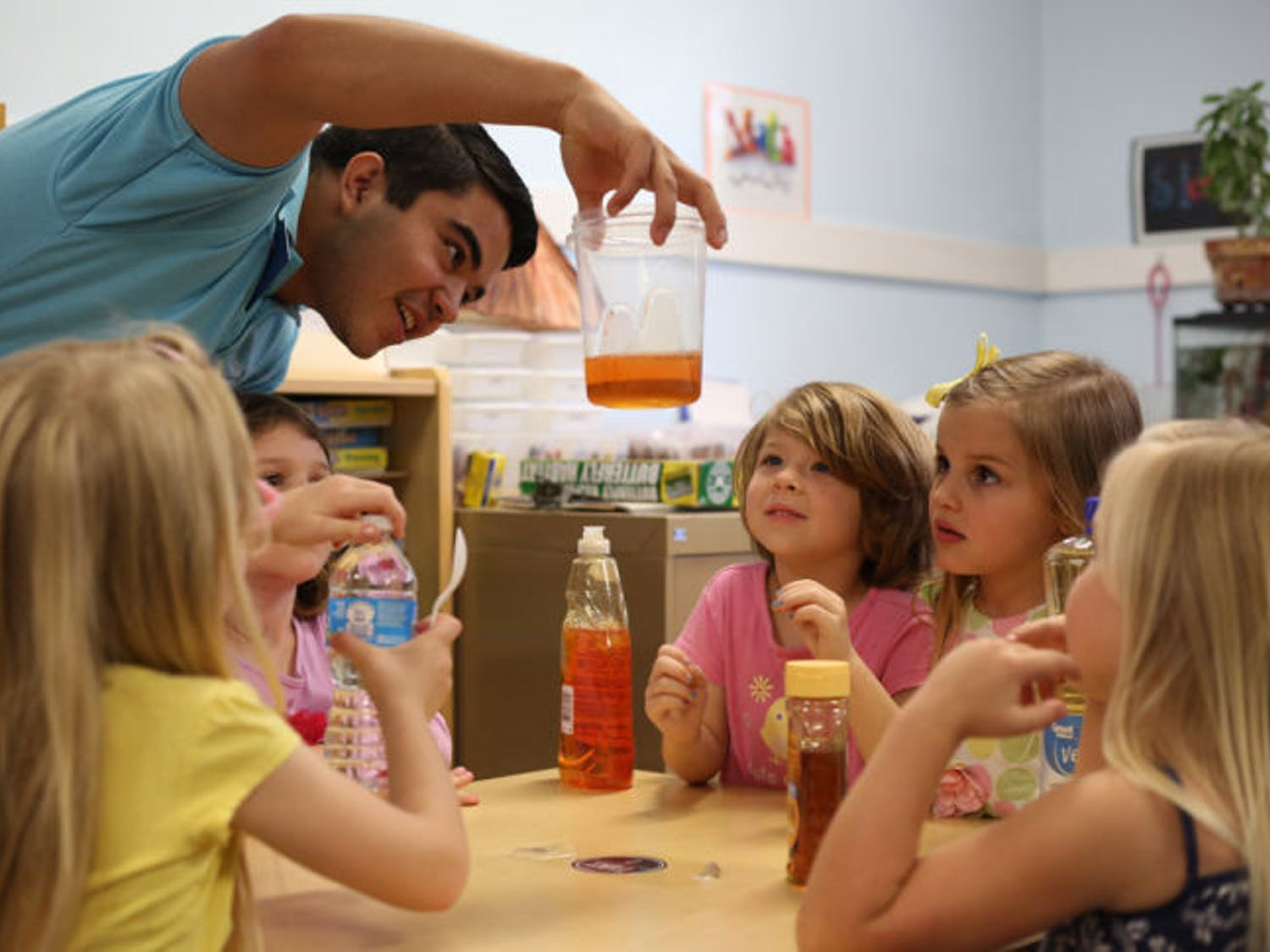 Engineering ambassador Fernando Barroso teaches Baby Gators about fluid density using soap, honey and water on Tuesday. EA and the American Institute of Aeronautics and Astronautics hosted an activity day at the preschool.