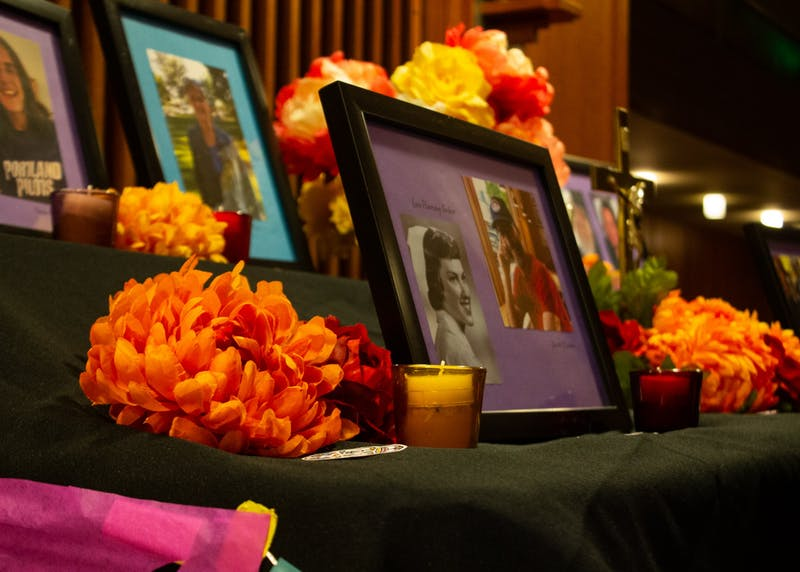 A colorful alter filled with photos of UP community member's loved ones who have passed. The ofrenda can be found in the Chapel of Christ the Teacher from October 29 through November 6.
