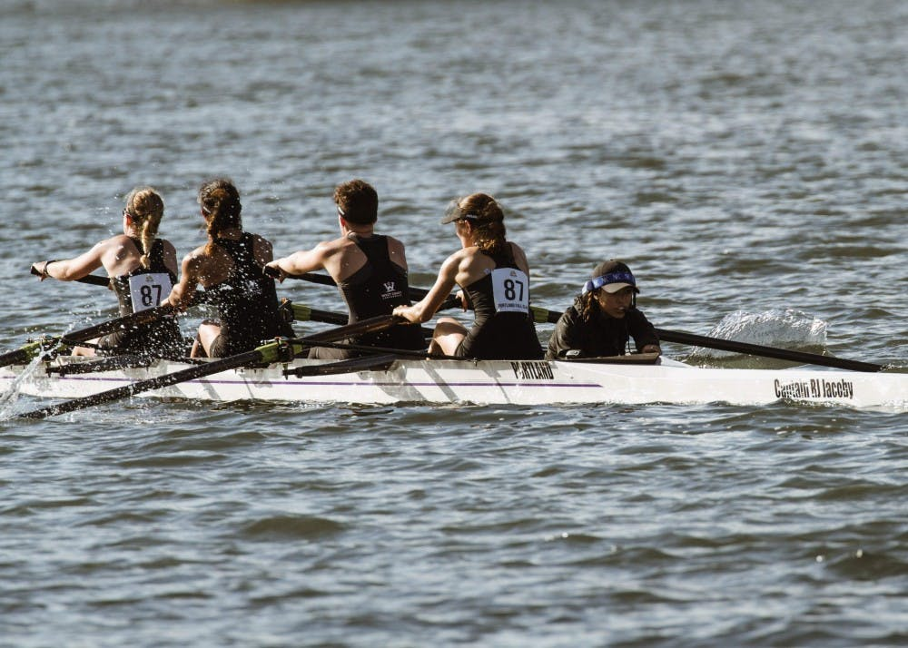 Senior coxswain Miranda Reyes gives commands to her boat.