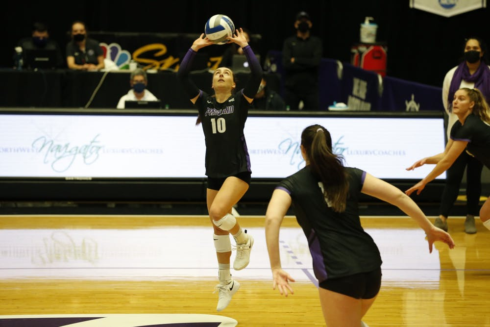 Senior Kellie Hughes setting the ball.Media Credit: University of Portland Athletics