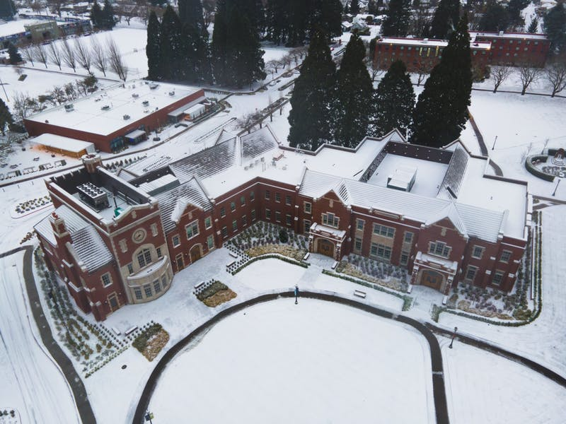 Dundon-Berchtold Hall sits among other snow-covered buildings on campus.